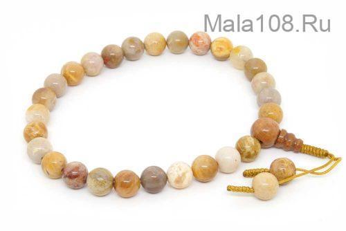 Буддийские четки-браслет из желтого коралла 27 бусин