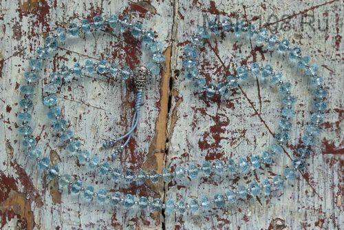 Буддийские четки из голубого топаза 108 бусин с серебряной гуру